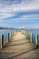 November skies over a landing stage on Windermere, at Brockhole, Cumbria - photographed in November