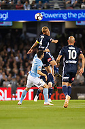 Melbourne Victory midfielder Keisuke Honda (4) wins the header at the Hyundai A-League Round 1 soccer match between Melbourne Victory and Melbourne City FC at Marvel Stadium in Melbourne.