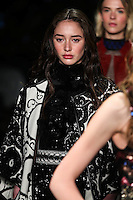 Karime Bribiesca walks the runway wearing Vivienne Tam Fall 2016 during New York Fashion Week on February 15, 2016