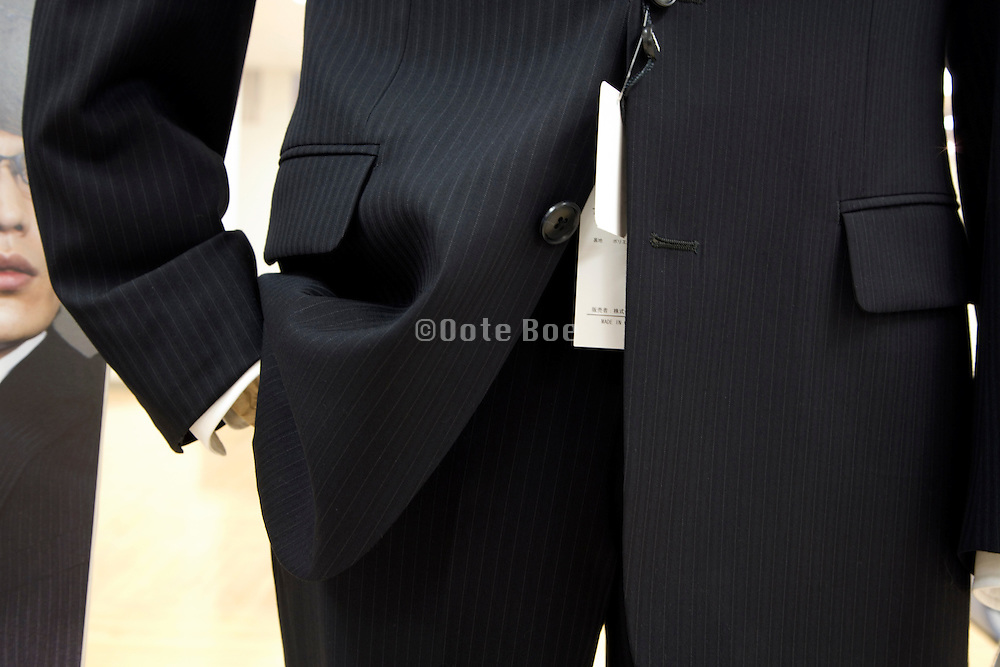black male business suit with sales label