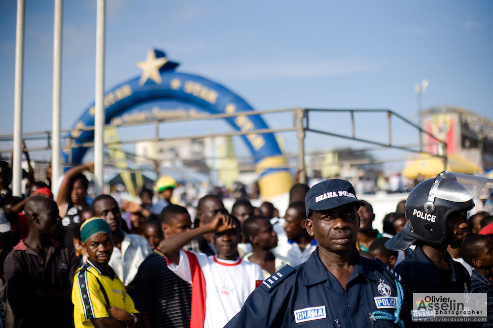 Police officers watch over the crowd during the annual Oguaa Fetu Afahye Festival in Cape Coast, Ghana on Saturday September 6, 2008.