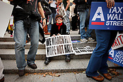 "A protester joining the demonstration orchestrated by Occupy Wall Street. Her sign reads ""We march for hope not hate"". The Occupy Wall Street demonstrated against financial greed and inequality and questioned the ethics of the financial business."