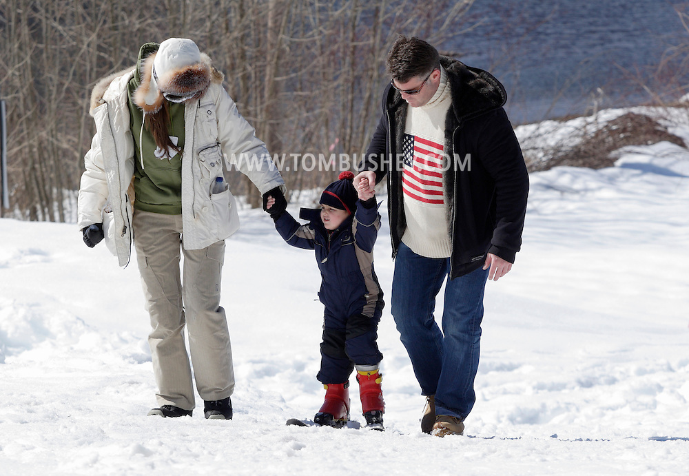 Bridgeville, New York - A couple helps a young skier up a slope at Holiday Mountain Ski Area on March 6, 2010.