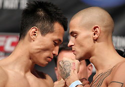Fairfax, VA - May 14, 2012: Chan Sung Jung (left) and Dustin Poirier (right) during the UFC on FUEL TV 3 weigh-in at the Patriot Center in Fairfax, Virginia.