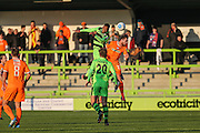 Forest Green Rovers Ethan Pinnock(16) and Braintree Town's Michael Cheek jump for the ball during the Vanarama National League match between Forest Green Rovers and Braintree Town at the New Lawn, Forest Green, United Kingdom on 21 January 2017. Photo by Shane Healey.