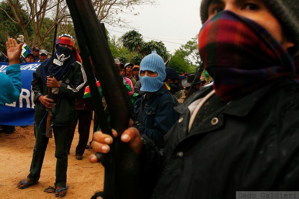 Bolivian farmers,supporters of president Evo Morales stand guard as a march against autonomy enters the small, opponent village of Buena Vista, some 100km north of Santa Cruz, Bolivia, Saturday, Sept. 20, 2008.  (AP Photo/Dado Galdieri)