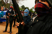 Bolivian farmers,supporters of president Evo Morales stand guard as a march against autonomy enters the small, opponent village of Buena Vista, some 100km north of Santa Cruz, Bolivia, Saturday, Sept. 20, 2008.  (AP Photo/Dado Galdieri)