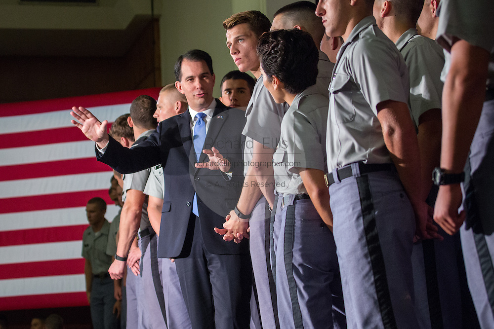 Wisconsin Governor and GOP presidential candidate Scott Walker poses with cadets after he gave a foreign policy speech at the Citadel military college August 28, 2015 in Charleston, South Carolina. Walker criticized Hillary Clinton as unfit for the presidency because of her role in negotiating with Iran and her use of a private email system.