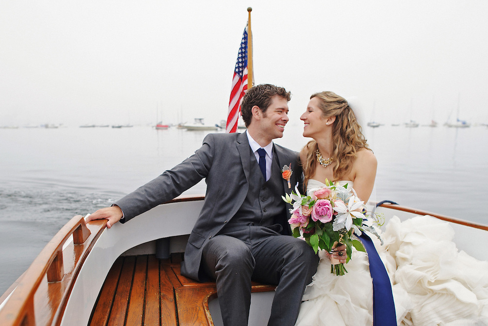 Camden Yacht Club Wedding in Maine with Maine Seasons Events.  The couple takes a boat from the ceremony to the reception.  Image by Maine Wedding Photographer, Puerto Vallarta Wedding Photographer, New York City Wedding Photographer and Philadelphia Wedding Photographer Michelle Turner.