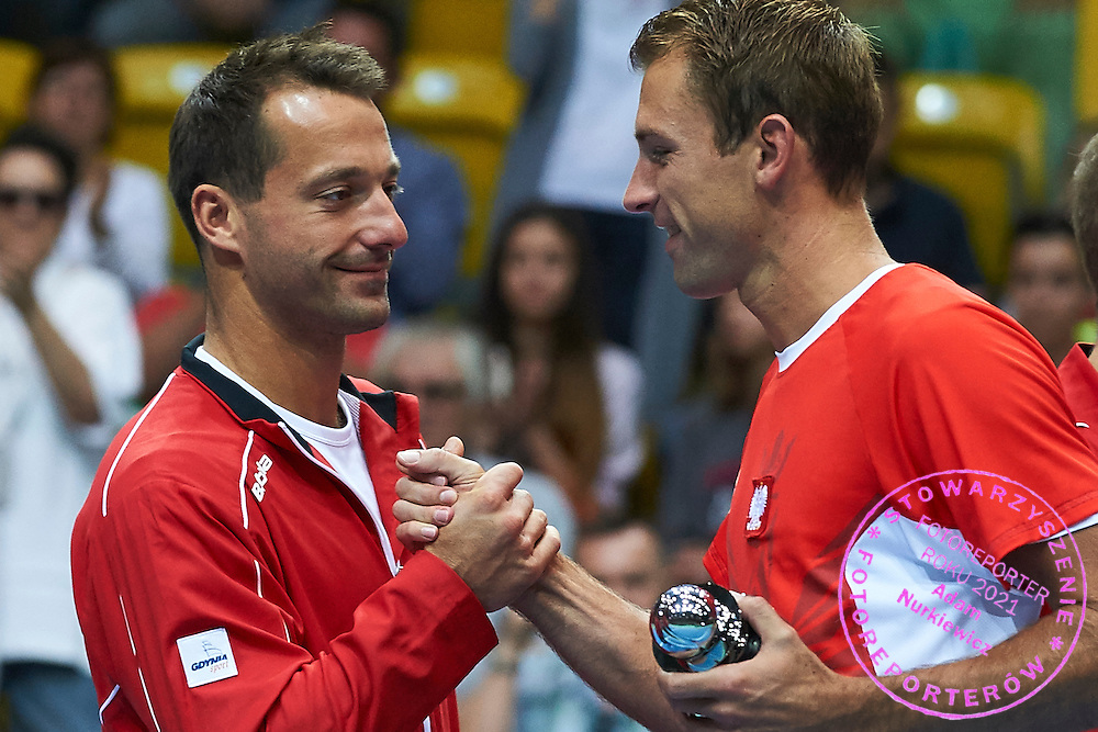 (L) trainer assistant Aleksander Charpantidis and (R) Lukasz Kubot both from Poland during Davis Cup Tie World Group Play-off Poland v Slovakia at Gdynia Arena Hall in Gdynia, Poland.<br /> <br /> Poland, Gdynia, September 20, 2015<br /> <br /> Picture also available in RAW (NEF) or TIFF format on special request.<br /> <br /> For editorial use only. Any commercial or promotional use requires permission.<br /> <br /> Adam Nurkiewicz declares that he has no rights to the image of people at the photographs of his authorship.<br /> <br /> Mandatory credit:<br /> Photo by &copy; Adam Nurkiewicz / Mediasport