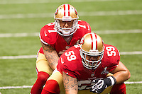 3 February 2013: Quarterback (7) Colin Kaepernick of the San Francisco 49ers rlins up behind center (59) Jonathan Goodwin against the Baltimore Ravens during the first half of the Ravens 34-31 victory over the 49ers in Superbowl XLVII at the Mercedes-Benz Superdome in New Orleans, LA.
