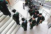 Graduates of the College of Podiatric Medicine line up for commencement at Cartwirhgt Hall.