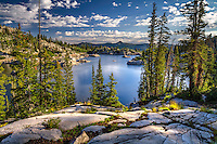 A classic landscape photograph of Lake Mary, high in the Wasatch Mountains above Salt Lake City, Utah at sunrise on a warm Summer day.