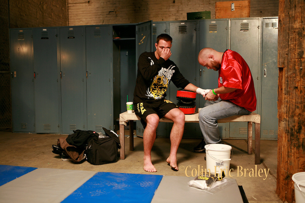 In the MMA fighter's locker room and in the cage. Still photography of Mark Burnett Productions February 2009 filming of the Mixed Martial Arts reality fight show, Bully Beat Down, with MMA fighter and host, Jason Mayhem Miller. The show airs on MTV. Photos by Colin Braley