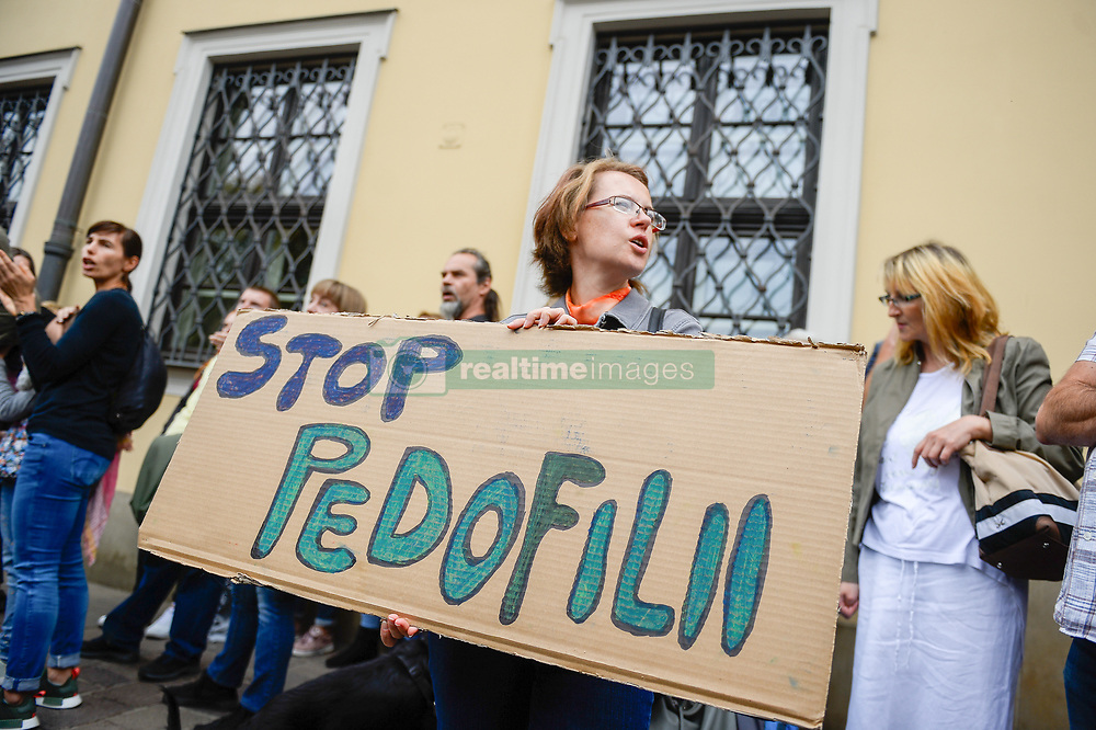 October 7, 2018 - Krakow, Poland - A woman see holding a banner written stop pedophilia at the Main Square during the protest..People take part in the Hands Away From Children, a protest against pedophilia by the Catholic Church where the organizers ask for solidarity with children who have experienced sexual violence from the representatives of the Catholic Church. (Credit Image: © Omar Marques/SOPA Images via ZUMA Wire)