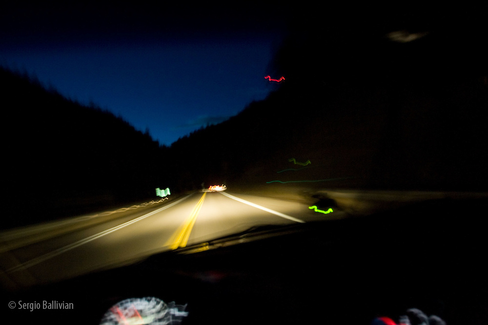 Driving at night through tunnels of Clear Creek Canyon near Golden, CO