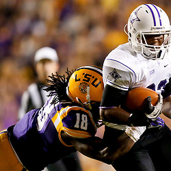 Oct 26, 2013; Baton Rouge, LA, USA; Furman Paladins running back Marcus Anderson (33) is tackled by LSU Tigers linebacker Lamin Barrow (18) during the first half of a game at Tiger Stadium. Mandatory Credit: Derick E. Hingle-USA TODAY Sports