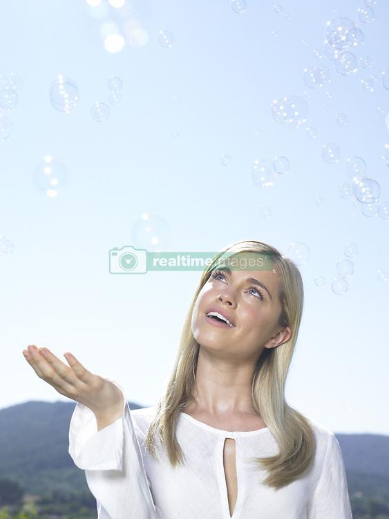 Jul. 10, 2008 - Girl looking at bubbles. Model Released (MR) (Credit Image: © Cultura/ZUMAPRESS.com)