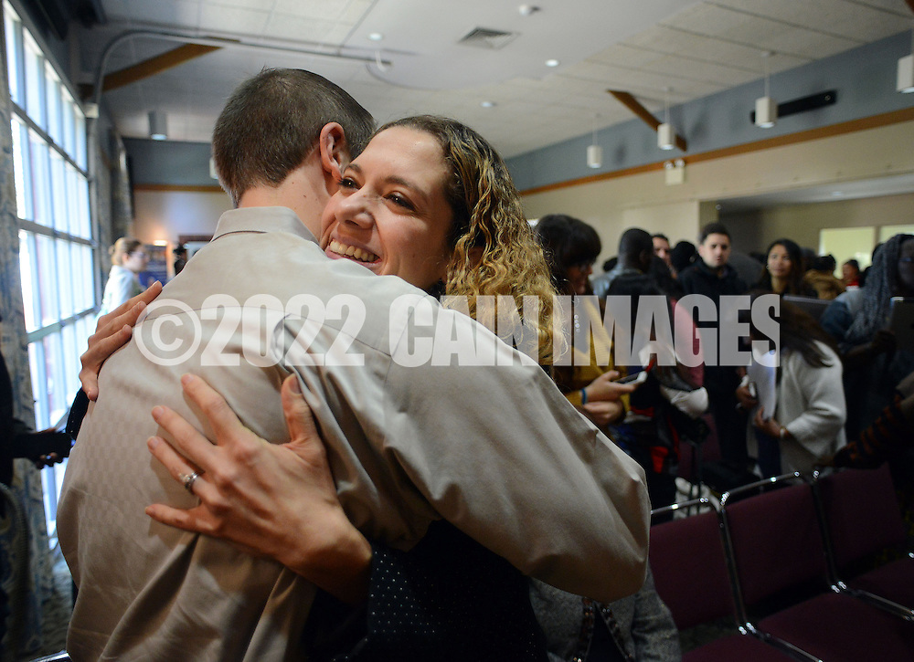 DUBLIN, PA - OCTOBER 24: Chris Hardin (L) congratulates his wife Angelica Cuellar Hardin of Columbia after she took the Oath of Citizenship with fellow applicants during a Naturalization ceremony October 24, 2014 at the Pearl S. Bucks House in Dublin, Pennsylvania. 48 applicants from 28 countries were naturalized during the ceremony, and became U.S. citizens. (Photo by William Thomas Cain/Cain Images)