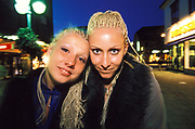 Two women outside with blond braided hair. UK 2000