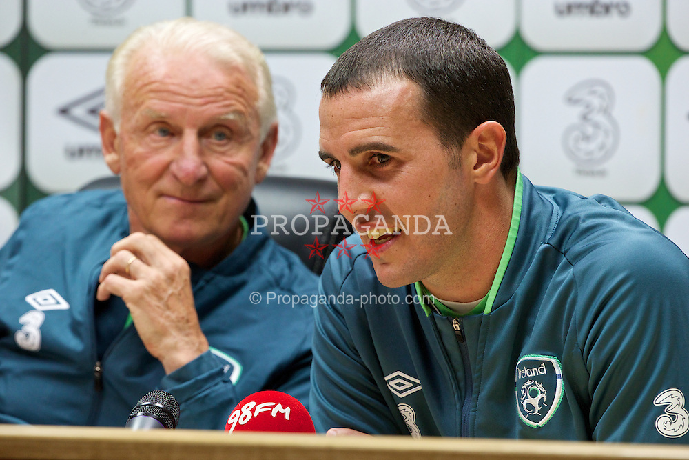 CARDIFF, WALES - Tuesday, August 13, 2013: Republic of Ireland's John O'Shea and head coach Giovanni Trapattoni during a press conference at the Cardiff City Stadium ahead of the International Friendly match against Wales. (Pic by David Rawcliffe/Propaganda)