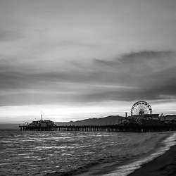 Santa Monica Pier California sunset vertical black and white photo. Santa Monica a costal beach city in Southern California in the United States. Copyright ⓒ 2017 Paul Velgos with All Rights Reserved.