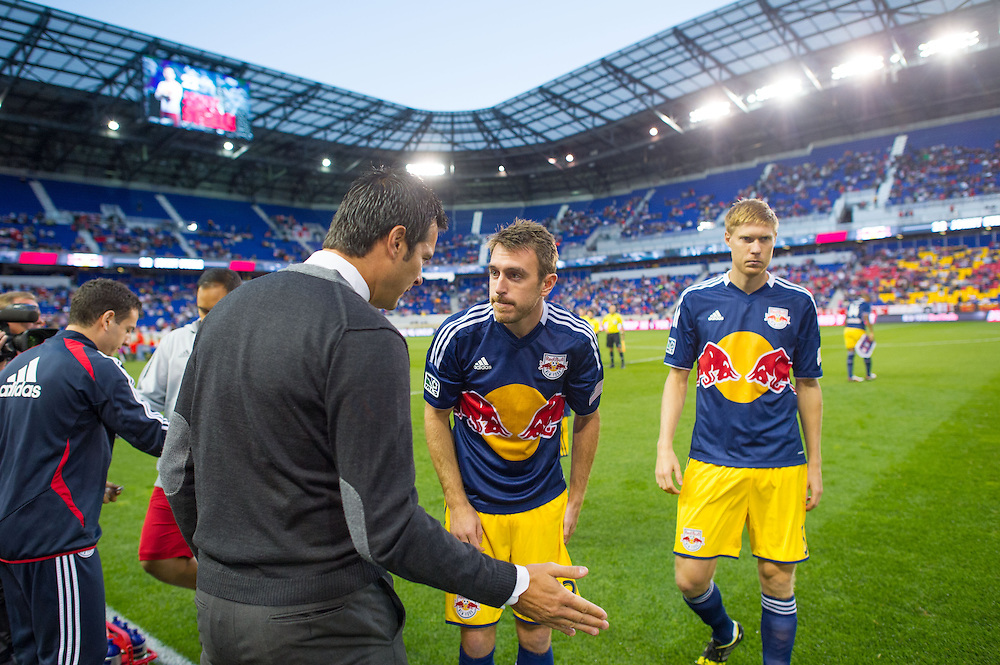 HARRISON, NJ - SEPTEMBER 14:  Mike Petke coach of the New York Red Bulls talks with his team before the game against the Toronto FC at Red Bulls Arena on September 14, 2013. (Photo By: Rob Tringali)