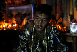 Mongolian Shaman Batgerel Batmunkh sits exhausted after coming out of his trance during a Shaman ceremony in their ger on the outskirts of Ulan Bator, Mongolia, 04 July 2012. Mongolian brothers Gankhuyag and Batgerel Batmunkh share a similar fate. Both were construction workers before fate calls on them to take on their Shamanic roles to serve the spirits. Shamanism comes from the term 'shamans' that refers to priests or mediums that acts as vessels for spirits, gods and demons to communicate with the human world. In Mongolia, they adhere to the ancient beliefs of Tengrism, where spirits live in all of nature, in the sun, moon, lakes, rivers, mountains, and trees.