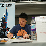 Business Design Centre, England, UK. 23rd August 2017. Jae Lee singing comic book for fans at the London Super Comic Convention 2017.