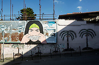 ROME, ITALY - 7 January 2014: Steret art on a wall and billboard in the Pigneto neighborhood of Rome, Italy, on February 7th 2014.