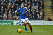 Portsmouth Defender, Matt Clarke (5) brings the ball out of defence during the EFL Sky Bet League 1 match between Portsmouth and Blackpool at Fratton Park, Portsmouth, England on 12 January 2019.