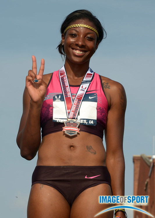 Jun 21, 2013; Des Moines, IA, USA; Nia Ali poses after placing third in the womens 100m hurdles in 12.48 in the 2013 USA Championships at Drake Stadium.