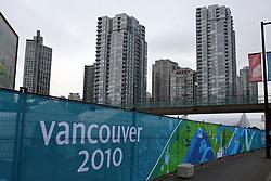 Olympic Winter Games Vancouver 2010 - Olympische Winter Spiele Vancouver 2010, barrier in fornt of skyline of Vancouver, Absperrung, Zaun vor der Skyline von Vancouver Photo by Malte Christians / HOCH ZWEI / SPORTIDA.com.