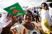 A Convention People's Party (CPP) supporter holds up her membership card during a rally in Accra, Ghana on Sunday September 21, 2008.