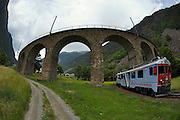 Bernina Express descending towards Tirano on the circular viaduct at Brusio.
