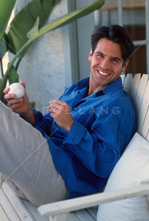 Man enjoying sitting on a balcony