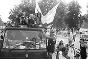Ravers cheering from their truck at the 2nd Criminal Justice March,  London, UK, 23rd of July 1994.