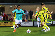 Forest Green Rovers Tahvon Campbell(14) and Cheltenham Town's Ryan Broom(11) go for the ba\\ during the EFL Trophy match between Forest Green Rovers and Cheltenham Town at the New Lawn, Forest Green, United Kingdom on 4 September 2018.