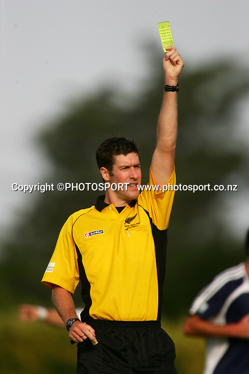 Referee Matthew Conger shows a yellow card during the NZFC soccer match between Hawkes Bay United and Auckland City played at Park Island, Napier, New Zealand, Saturday 05 January, 2008. The match ended 1-0 to Auckland City. Photo: John Cowpland/PHOTOSPORT