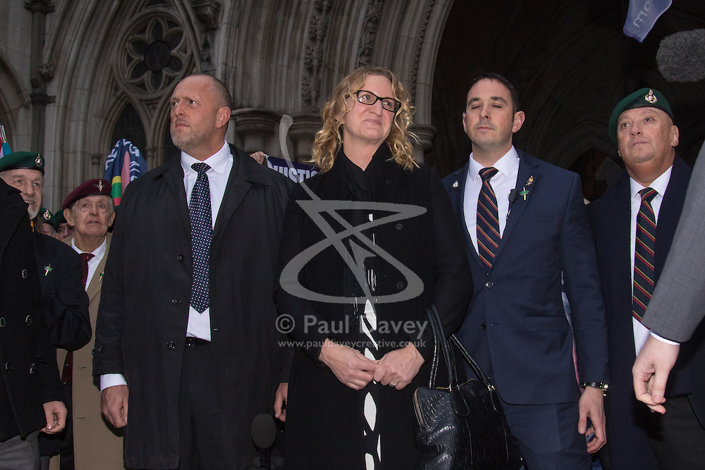 Royal Courts of Justice, London, February 8th 2017. As day two for the appeal hearing for 'Marine A' - Sgt Alex Blackman draws to a close, retired Marines and supporters gather on the steps of the High Court as his wife Claire emerges from the building. PICTURED: Claire Blackman emerges from the High Court to cheers from supporters of her Husband Sgt Alex Blackman.