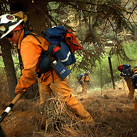 California Department of Corrections Malibu Camp 13 Crew 4 Firefighters work ahead as the Butler II fire approaches in the San Bernardino National Forest near Fawnskin, Sunday, Sept. 16, 2007.