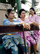 Thai women dressed in Rama V period costume for a cultural parade.