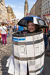 Edinburgh, Scotland, UK. 3 August 2019. On the first weekend of the Edinburgh Fringe Festival good weather brought out thousands of tourists to enjoy the many street performers  on the Royal Mile in Edinburgh Old Town. Pictured Stillwater Area High School from Minnesota production of Hamluke Iain Masterton/Alamy Live News