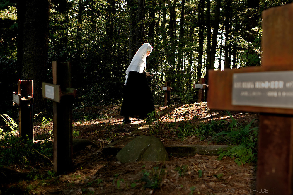 BETHLEHEM, CT- 11 OCTOBER 2005- Sister Angele walks through the private cemetery at the Abbey of Regina Laudis in Bethlehem. The cemetery is the final resting place for the community of Benedictine nuns. (Photo by Robert Falcetti)