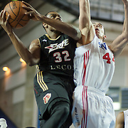 Erie BayHawks Forward Justin Brownlee (32) drives towards the basket as Delaware 87ers Center Ben Strong (44) defends in the second half of a NBA D-league regular season basketball game between the Delaware 87ers (76ers) and the Erie BayHawks (Knicks) Monday, Jan 13, 2014 at The Bob Carpenter Sports Convocation Center, Newark, DE