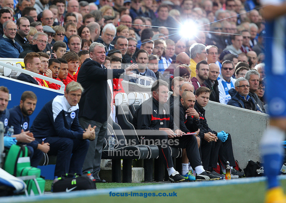Steve Evans ( centre left ), Manager of Rotherham United during the Sky Bet Championship match at the American Express Community Stadium, Brighton and Hove<br /> Picture by Paul Terry/Focus Images Ltd +44 7545 642257<br /> 25/10/2014