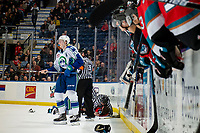 KELOWNA, BC - OCTOBER 16: Linesman Cody Wanner separates Mark Liwiski #9 of the Kelowna Rockets from a fight against the Swift Current Broncos at Prospera Place on October 16, 2019 in Kelowna, Canada. (Photo by Marissa Baecker/Shoot the Breeze)