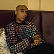 Irish hip hop recording artist, Rejjie Snow, relaxing in a backstage room at the Olympia Theatre in Dublin, Ireland, ahead of his live concert on March 12, 2018. CREDIT: Paulo Nunes dos Santos for The New York Times