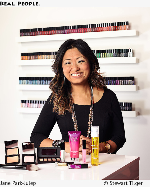 Julep CEO, Jane Park, with beauty products in Seattle office.