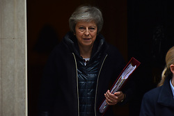 November 21, 2018 - London, United Kingdom - British Prime Minister Theresa May leaves 10 Downing Street as she makes her way to the Parliament to attend Prime Minister Questions session (PMQs), before heading to Brussels, on November 21, 2018. Mrs May is set to meet President of the European Commission, Jean Claude Junker, to finalise Brexit deal. (Credit Image: © Alberto Pezzali/NurPhoto via ZUMA Press)